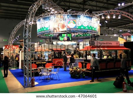 MILAN, ITALY - FEBRUARY 20: People walk through Dotto touristic trains stand at BIT, International Tourism Exchange Exhibition February 20, 2010 in Milan, Italy.