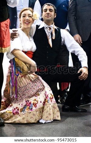 MILAN, ITALY - FEBRUARY 17: Performers dressing in traditional sicilian outfit at BIT International Tourism Exchange on february 17, 2012 in Milan, Italy. - stock photo