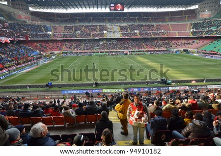 MILAN, ITALY - FEBRUARY 05: Seller snacks and football fans before match Sere A AC Milan - Napoli (0:0) at the stadium San Siro on February 05, 2012 in Milan, Italy.