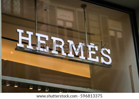 Milan, Italy - February 28, 2017: Shop window of a Hermes shop in Milan - Montenapoleone area, Italy. Few days after Milan Fashion Week. Spring Summer 2017 Collection. Hermes logo