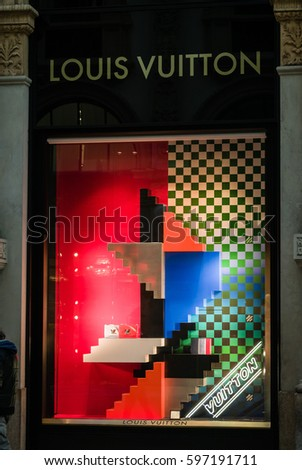 Milan, Italy - February 28, 2017: Shop window of a Louis Vuitton shop in Milan - Montenapoleone area, Italy. Few days after Milan Fashion Week. Spring Summer 2017 Collection. Louis Vuitton logo