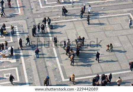 MILAN, ITALY - FEBRUARY, 13: Top view of people in the Piazza Duomo from Milan cathedral on February 13, 2010 - stock photo