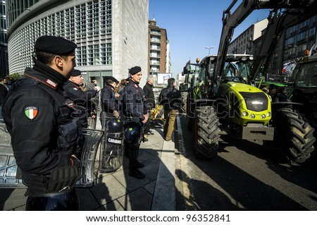 MILAN, ITALY - FEBRUARY 22: Tractors manifestation in Milan on February, 22 2012. Northen Italy farmers protest against milk quotas crossing the city of Milan with tractors.