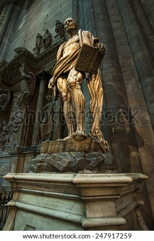 Milan ( Italy ) 25/01/2015: inside the Milan cathedral there are a lot of statues that you can find going around the church. In every part of the church tourists are attracted by pieces of art. - stock photo