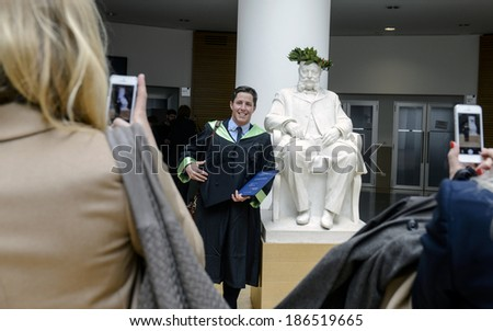 MILAN, ITALY-JANUARY 13, 2012: A student of the Bocconi University, poses for pictures during the graduation day, in Milan. - stock photo