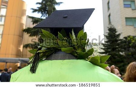 MILAN, ITALY-JANUARY 12, 2012: A student of the Bocconi University, wears the graduation cap and the laurel crown, during the graduation day, in Milan. - stock photo