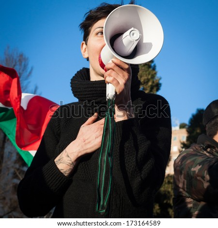 MILAN, ITALY - JANUARY 25: Demonstrator of the so-called December 9 movement speaks through loudhailer to protest against government and political class on JANUARY 25, 2013 in Milan.  - stock photo