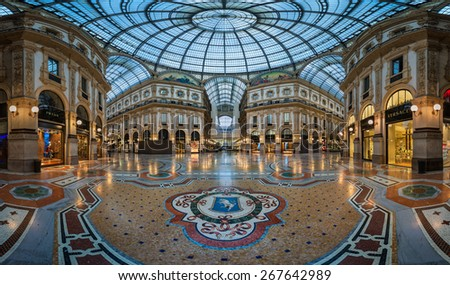 MILAN, ITALY - JANUARY 13, 2015:  Famous Bull Mosaic in Galleria Vittorio Emanuele II. It's one of the world's oldest shopping malls, designed and built by Giuseppe Mengoni between 1865 and 1877. - stock photo