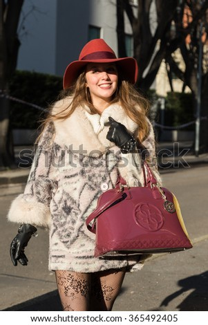 MILAN, ITALY - JANUARY 18: People gather outside Armani fashion show building for Milan Men's Fashion Week on JANUARY 18, 2016 in Milan.