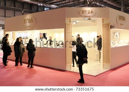 MILAN, ITALY - JANUARY 28: People visit stands looking for design and interior decoration products at Macef, International Home Show Exhibition January 28, 2011 in Milan, Italy.