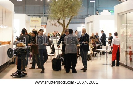 MILAN, ITALY - JANUARY 15: People walk through stands at Macef, International Home Show Exhibition January 15, 2010 in Milan, Italy.