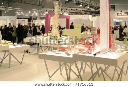 MILAN, ITALY - JANUARY 28: People walk through stands looking for design and interior decoration products at Macef, International Home Show Exhibition January 28, 2011 in Milan, Italy.