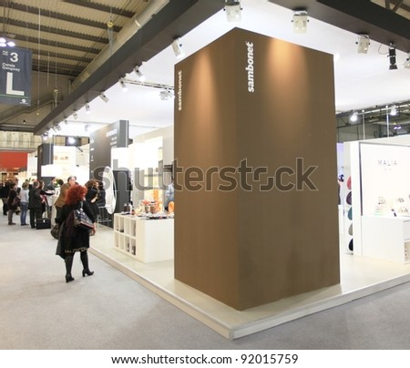 MILAN, ITALY - JANUARY 28: People walking trough stands looking for design and interior decoration products at Macef, International Home Show Exhibition January 28, 2011 in Milan, Italy. - stock photo