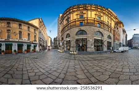 MILAN, ITALY - JANUARY 2, 2015:  Via Cesare Beccaria and Excelsior Department Store in Milan. Excelsior Store belongs to the Coin Group which is Italyas largest clothing retailer. - stock photo