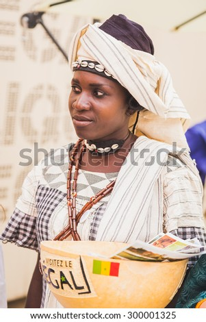MILAN, ITALY - JULY 22: African woman in her traditional clothing poses at Expo, universal exposition on the theme of food on JULY 22, 2015 in Milan.