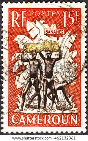 Milan, Italy - July 21, 2016: Banana carriers on postage stamp of Cameroon
