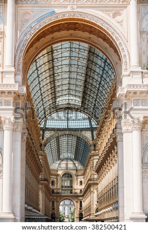 Milan, Italy  - July 01, 2015: Detail of wall and roof of Vittorio Emmanuele II shopping gallery or Highline Galleria in Milan, Italy. Architectural background. - stock photo