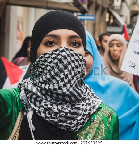 MILAN, ITALY - JULY 26: People march and protest against Gaza strip bombing in solidarity with Palestinians on JULY 26, 2014 in Milan. - stock photo