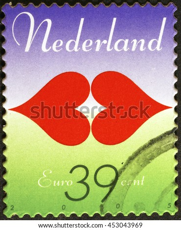Milan, Italy - July 15, 2016: Two hearts on dutch postage stamp - stock photo