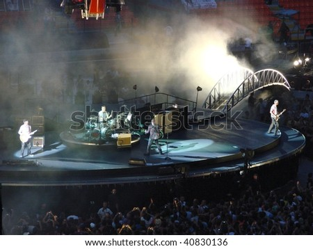 MILAN, ITALY - 8, JULY: U2 rock band perform during the U2 360° Tour concert , on the 8 July, 2009 in Milan, Italy. - stock photo