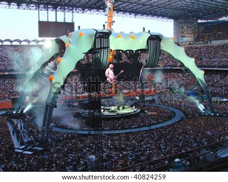 MILAN, ITALY - JULY 8: U2 rock band perform during the U2 360° Tour concert on the 8 July, 2009 in Milan, Italy. - stock photo