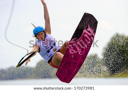 MILAN, ITALY - JULY 14: World Wakeboard Championship at the Idroscalo lake in Milan July 14, 2011. Nancy Eve Creedy (GBR) during the Junior Women Quarter Finals. - stock photo