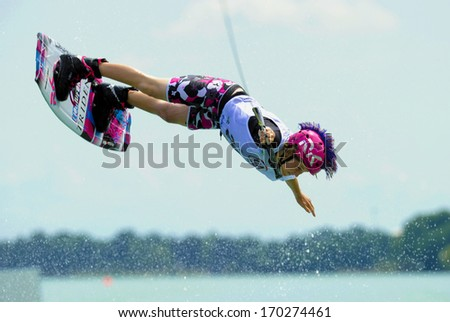 MILAN, ITALY - JULY 14: World Wakeboard Championship at the Idroscalo lake in Milan July 14, 2011. Megan Barker (GBR) during the Junior Women Quarter Finals. - stock photo