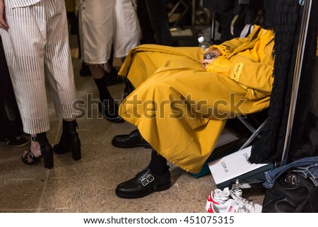 MILAN, ITALY - JUNE 19: Detail of a model sitting in the backstage just before Damir Doma SS 17 show during Milan Men's Fashion Week on JUNE 19, 2016 in Milan. - stock photo