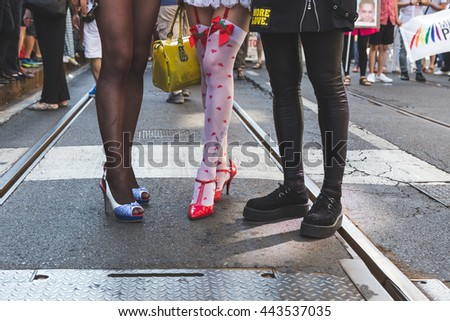 MILAN, ITALY - JUNE 25: Detail of legs and shoes at Pride parade in Milan JUNE 25, 2016. Thousands of people march in the city streets for the annual Pride parade, claiming equality and legal rights. - stock photo