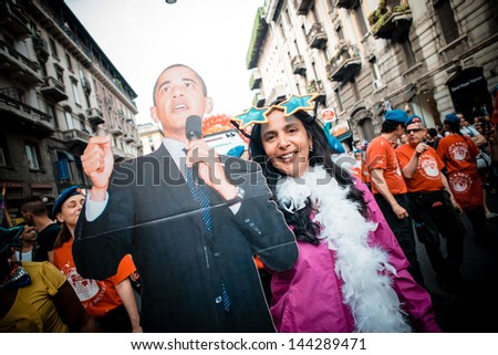 MILAN, ITALY - JUNE 29: Gay Pride Parade & Celebration in Milan June 29, 2013. Participants take to the street for their rights organizing a street parade party