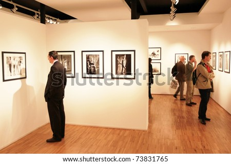 """MILAN, ITALY - JUNE 16: People look at """"On the scene"""" Phil Stern photography collection at Forma Photography Foundation June 16, 2010 in Milan, Italy. - stock photo"""