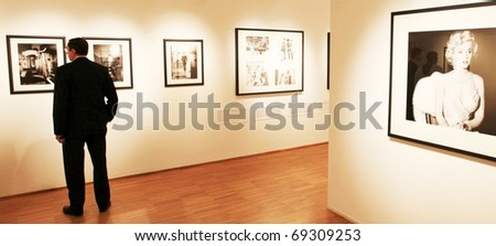 MILAN, ITALY - JUNE 16: People look at Phil Stern photography collection at Forma Photography Foundation June 16, 2010 in Milan, Italy. - stock photo