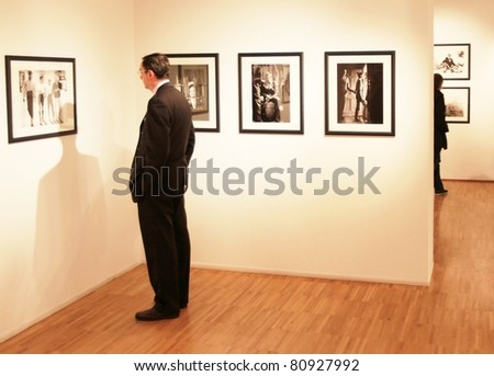 MILAN, ITALY - JUNE 16: People look at Phil Stern photos exhibition at Forma Photography Foundation June 16, 2010 in Milan, Italy. - stock photo