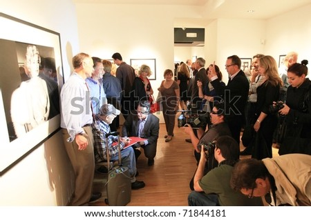 MILAN, ITALY - JUNE 16: Phil Stern with people and photographers at On the scene collection opening at Forma Photography Foundation June 16, 2010 in Milan, Italy. - stock photo