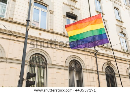 MILAN, ITALY - JUNE 25: Rainbow flag at Pride parade in Milan JUNE 25, 2016. Thousands of people march in the city streets for the annual Pride parade, claiming equality and legal rights. - stock photo