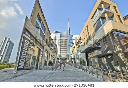 MILAN, ITALY- JUNE 11, 2015: Some people walking in the direction of the piazza Aulenti and the Unicredit Tower, Milano skyline palazzo Unicredit - stock photo