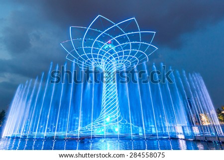 MILAN, ITALY - JUNE 01, 2015: The tree of life (Albero della vita in Italian) during night water-play show. The tree of life is the symbol of Expo 2015 area. - stock photo