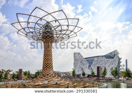 MILAN, ITALY - JUNE 6 2015: View of The tree of life and the Italian pavilion. The tree of life is the symbol of Expo 2015 universal exposition on the theme of food - feed the planet. - stock photo
