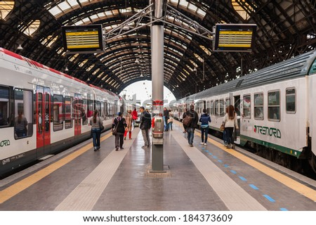 MILAN, ITALY - MAR 29, 2014: Train SBB and Trenord comanies on the platforms of the Milano Centrale - The main railway stration of Milan, Italy. It was opened on July 1, 1931.