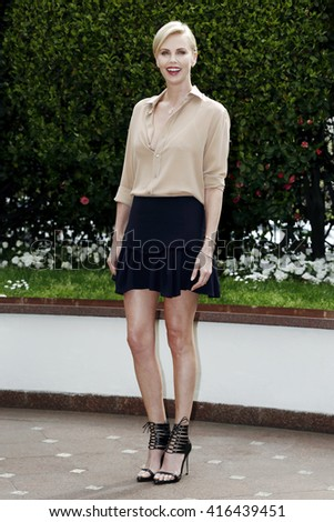MILAN, ITALY, MARCH 31: Actress Charlize Theron attends the photo-call of The Huntsman: Winter's War, in Milan on March 31, 2016 in Milan, Italy. - stock photo