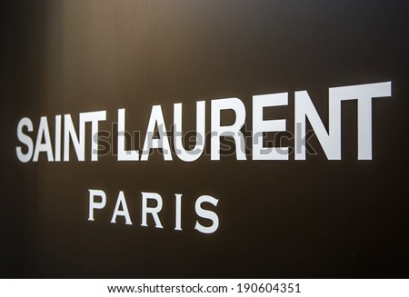 MILAN, ITALY - MARCH 9, 2014: Detail of Saint Laurent shop in Milan. is a luxury fashion house founded by Yves Saint Laurent at 1962 in PAris, France. - stock photo