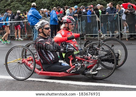 MILAN, ITALY - MARCH 23: Disabled athletes take part in Stramilano, traditional half marathon through the city streets on MARCH 23, 2014 in Milan. - stock photo