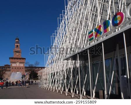 Milan, Italy - March 5, 2015: Expo 2015 Gate in Piazza Castello, Milan, Italy with the Sforza Castle in background on March 5, 2015. Expo 2015 is the next Universal Exposition. - stock photo