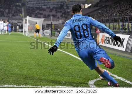 MILAN, ITALY- MARCH 19, 2015: FC Internazionale player Hernanes kiks the ball at the corner during the UEFA Europa League match FC Internazionale vs Wolfsburg, at the San Siro stadium, in Milan - stock photo