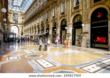 MILAN, ITALY-MARCH 19, 2014: interior of the Gallery Vittorio Emanuele, with luxury  shopping stores, in milan. - stock photo