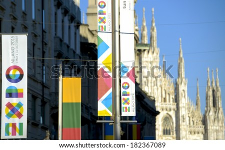 MILAN, ITALY-MARCH 17, 2014: International Exhibition EXPO 2015 banners, exposed in front of the Duomo cathedral, in Milan. - stock photo