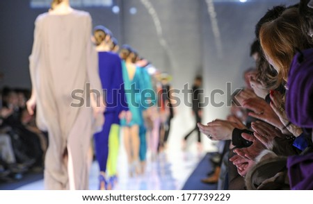 MILAN, ITALY-MARCH 01, 2010: Models on runway catwalk during the spring-summer fashion collection of Mila Schon. - stock photo