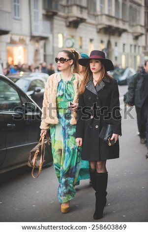 MILAN, ITALY - MARCH 01: People during Milan Fashion week, Italy on March, 01 2015. Eccentric and fashionable people outside city during Milan fashion week wait for models and famous people