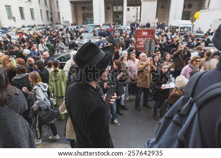 MILAN, ITALY - MARCH 1: People gather outside Ferragamo fashion show building for Milan Women's Fashion Week on MARCH 1, 2015  in Milan.