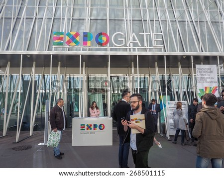 MILAN, ITALY - MARCH 28, 2015: People in front of the Expo Gate information centre in Milan as part of the Expo Milano 2015 international exhibition - stock photo